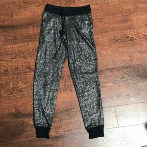 Black and silver joggers.